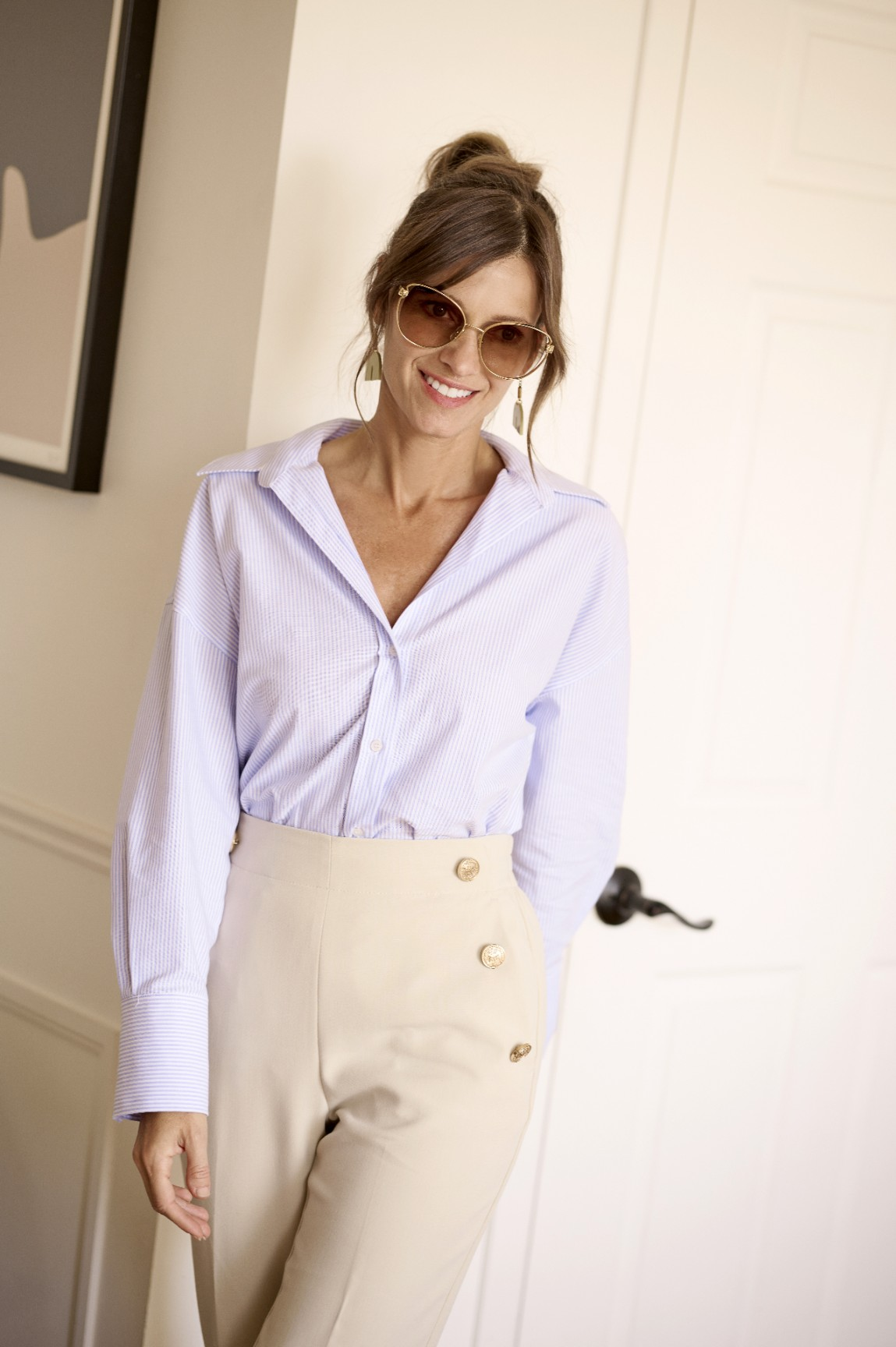 Classy business casual woman with sunglasses